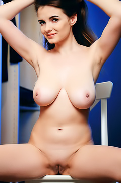 Young Brunett Babe Showing Her Round Boobs