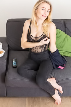 Aislin - Blonde beauty in black lingerie on the couch